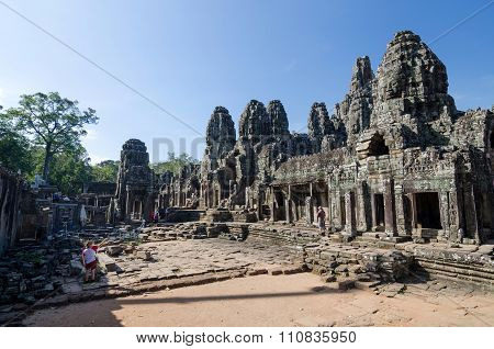 Siem Reap, Cambodia - December 3, 2015: Tourists At Bayon Temple On December 3, 2015.