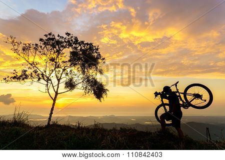 Cyclist during sunset at rural background
