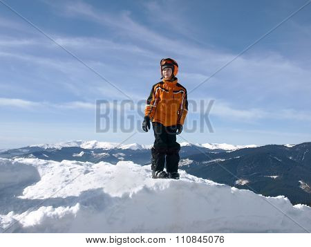 Little Skier On A Pile Of Snow