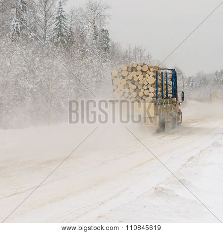 Logging Truck On Winter Road