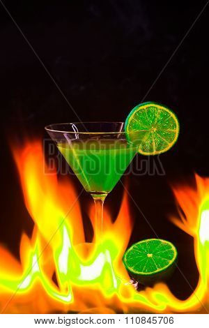 Colorful Cocktail In Nice Green Color To Front Of A Black Background And  Fire