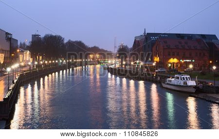 Night view of Danes river in the Old Town district. Klaipeda city, Lithuania.