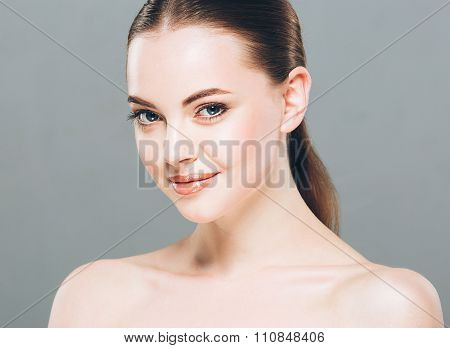 Beauty Woman Face Portrait. Beautiful Spa Model Girl With Perfect Fresh Clean Skin. Gray Background