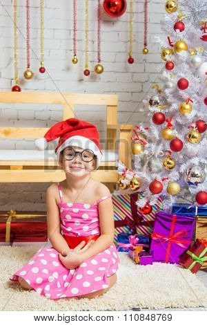 Funny Girl Gnome Sitting On A Mat In A Christmas Setting