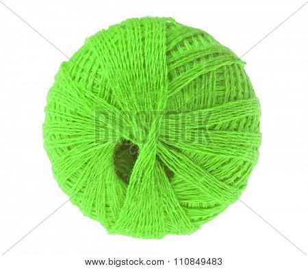 clew of green thread isolated on white background