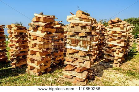 Very Unusual Way Of Stacking  Cut Wood Logs