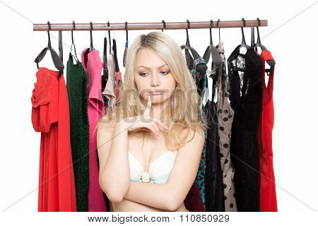 girl in underwear from clothes hangers. Isolated white background. choice of dress. person makes a c