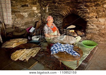 Senior Woman Making Pastry For Traditional Food Gozleme Inside Rustic Kitchen Of Old Turkish Village