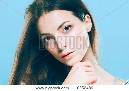 Beauty Woman Face Portrait. Beautiful Spa Model Girl With Perfect Fresh Clean Skin. Blue Background