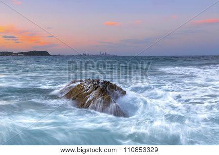 Ocean current rock sunset
