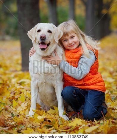 Girl with her dog labrador
