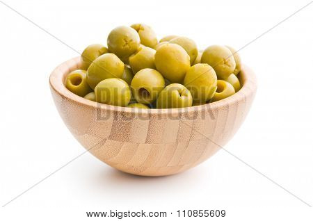 pitted green olives in bowl on white background