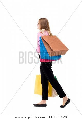back view of going  woman  with shopping bags . beautiful girl in motion.  backside view of person. solated over white background. The woman is left businessman with lots of bags.
