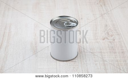 tin can on white wood background.