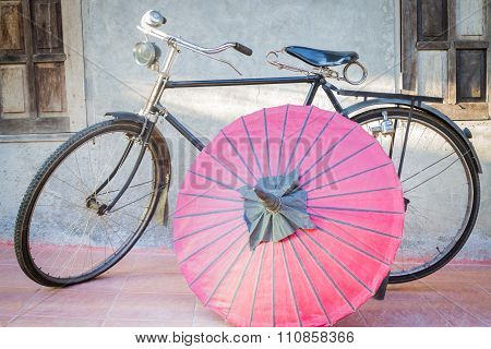 Old Vintage Bicycle And Paper Umbrella