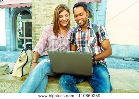 Indian man showing to american girl  laptop -  Students Models