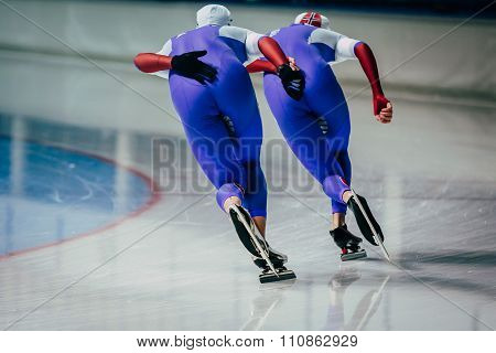 closeup two men skaters synchronous running