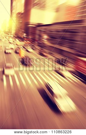 Cars in motion blur on the street during sunset.