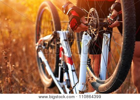 Bike repair. Young man repairing mountain bike