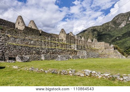 Between The Houses At Machu Picchu, The Sacred City Of Incas, Peru
