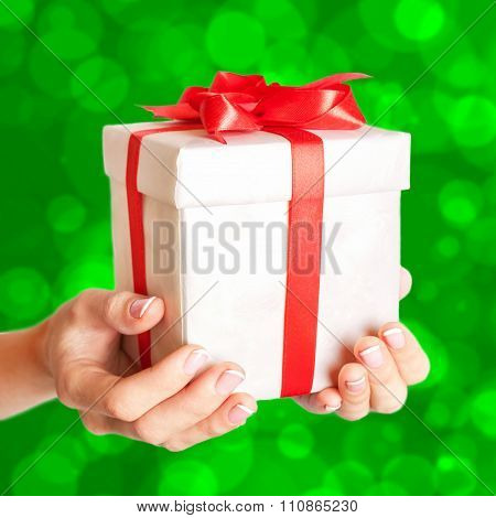 Hands Holding A Gift Box. Time Gifts.