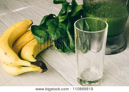 Smoothies In The Food Processor, Empty Glass, Banana And Spinach On A White Wooden Table