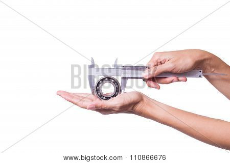 Female Engineer Use Vernier To Measure Old Bearing On White Background