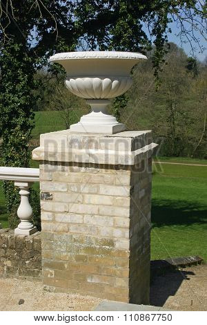 Ornamental jardiniere on brick pillar