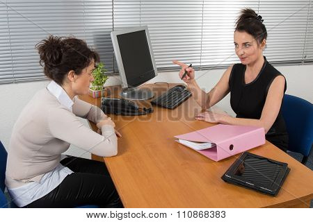 Serious Buisness Woman During A Business Appointment
