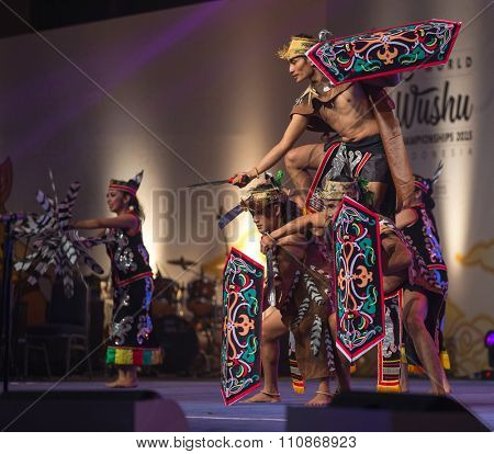 JAKARTA, INDONESIA: NOVEMBER 13, 2015: Dancers perform a traditional Kalimantan Dayak dance at the opening ceremony of the 13th World Wushu Championship 2015 in Jakarta Convention Centre.