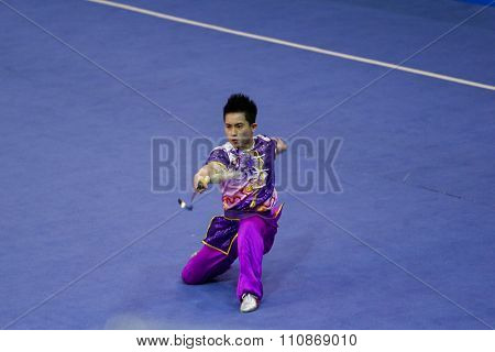JAKARTA, INDONESIA: NOVEMBER 14, 2015: Wong Weng Son from Malaysia performs the movements in the men's Jianshu (swords) event at the 13th World Wushu Championship 2015 at Istoran Senayan.