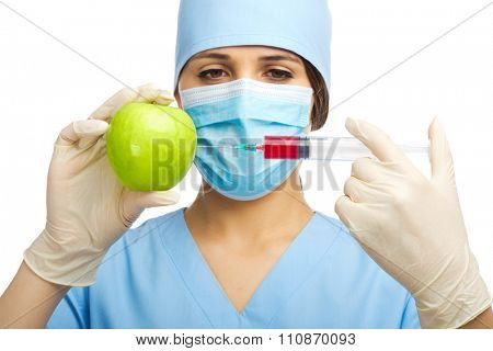 Chemist with syringe and apple isolated
