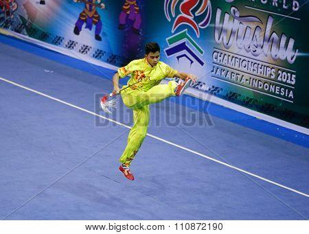 JAKARTA, INDONESIA, NOVEMBER 14, 2015: Jesse Adalia from Singapore performs the movements in the men's Jianshu (sword) event at the 13th World Wushu Championship 2015 held in Istora Senayan, Jakarta.