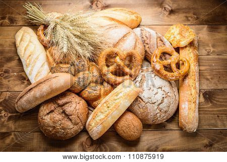 fresh bread  and wheat on the wooden board