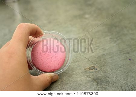 Hands Of The Woman Picked A Macaron