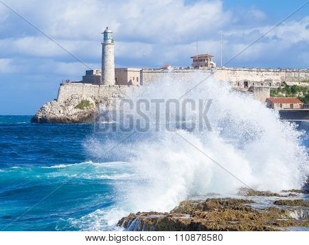 El Morro castle in Havana with sea waves crashing on the Malecon seawall
