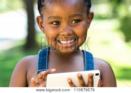 Cute Afro Girl Playing On Smart Phone.