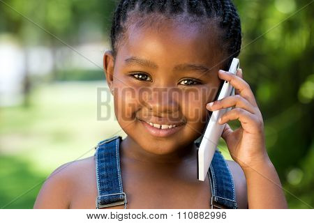 Portrait Of African Youngster Talking On Smart Phone.
