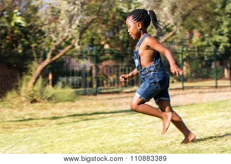 Side View Of African Kid Running In Park.