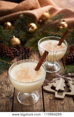 Eggnog traditional homemade egg, milk, rum, vanilla alcohol liqueur preparation recipe in two glass