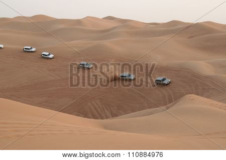 Column of crossovers travelling in sand desert