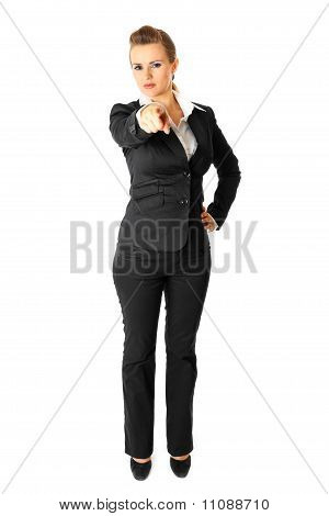 Full length portrait of modern business woman pointing finger at you isolated on white