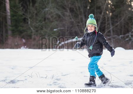 Handsome Young Boy In The Winter Forest.