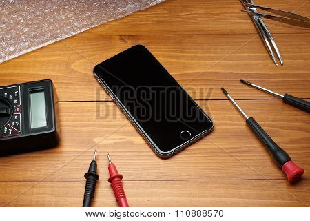 Repaired Smartphone With Tools
