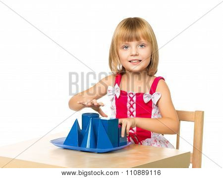 Girl playing at the table