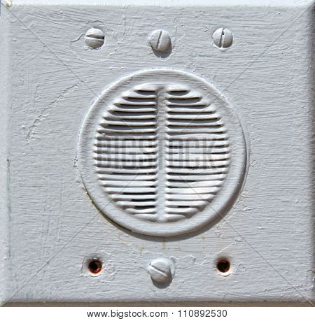 image from stone and metal texture background series (vintage speaker or intercom that has been painted over)