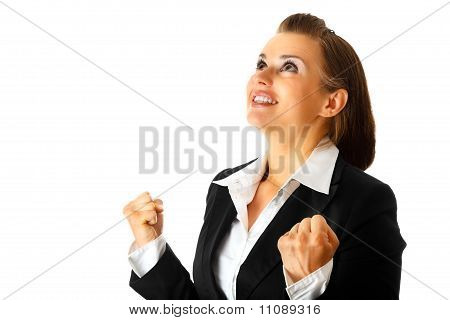 Excited modern business woman rejoicing her success isolated on white