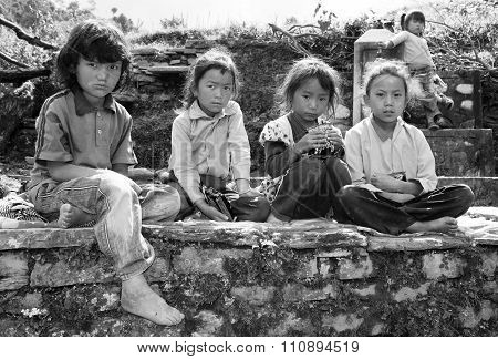 Nepalese Children Sitting On The Wall Before School