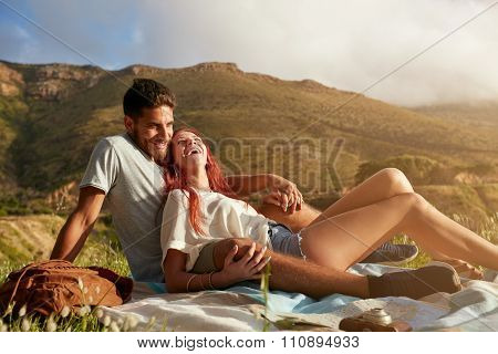 Young Couple Enjoying Picnic On A Summer Day