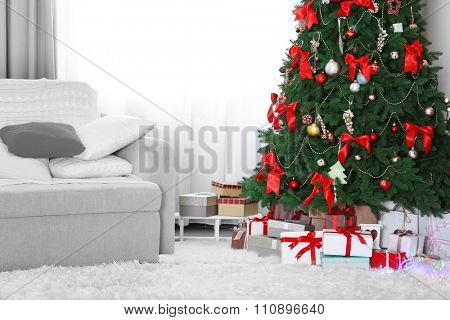 Christmas tree with gifts underneath in living room